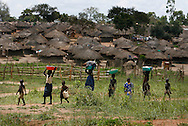 October 7, 2006 - Children carry laundry in Tetugu camp for internally displaced people, or IDP, near Gulu in north Uganda. Tetugu, with a population of 22,000, is one of 76 IDP camps around Gulu, the main base for the Uganda Peoples Defense Force fighting the insurgent Joseph Kony's Lord's Resistance Army. Kony's LRA movement has been fighting for the past 20 years to force the East African country to be ruled according to the Christian Ten Commandments. Over 2 million people, mostly of the Acholi tribe, have moved or were forced to move from their villages to camps close to the towns of Gulu, Lira, and Kitgum where they are watched over by the Ugandan Army. The LRA rebels have abducted thousands of children and have forced them to fight against the Ugandan Army and the Acholi people. Current peace talks between Kony's LRA and the Ugandan government held in Juba, southern Sudan, offer a glimpse of hope to ending this ongoing conflict..(Photo by Jakub Mosur/Polaris)<br />