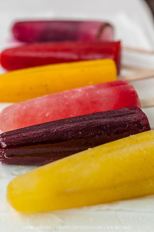 Fresh fruit popsicles in these flavors:  strawberry, watermelon/lemon/mint, pineapple/lime/ginger, mango/lime/ginger/coriander, raspberry/maple/lime, pink lemonade, blackberry/mandarin orange