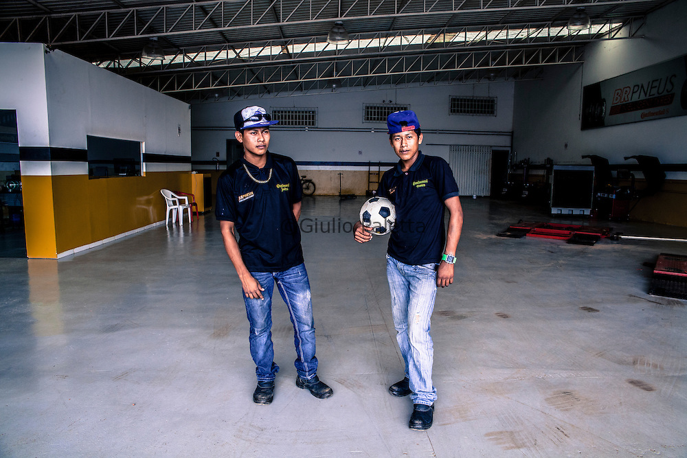 Young Guyanese workers photographed inside the factory where they work owned by a Brazilian man in Lethem, Guyana