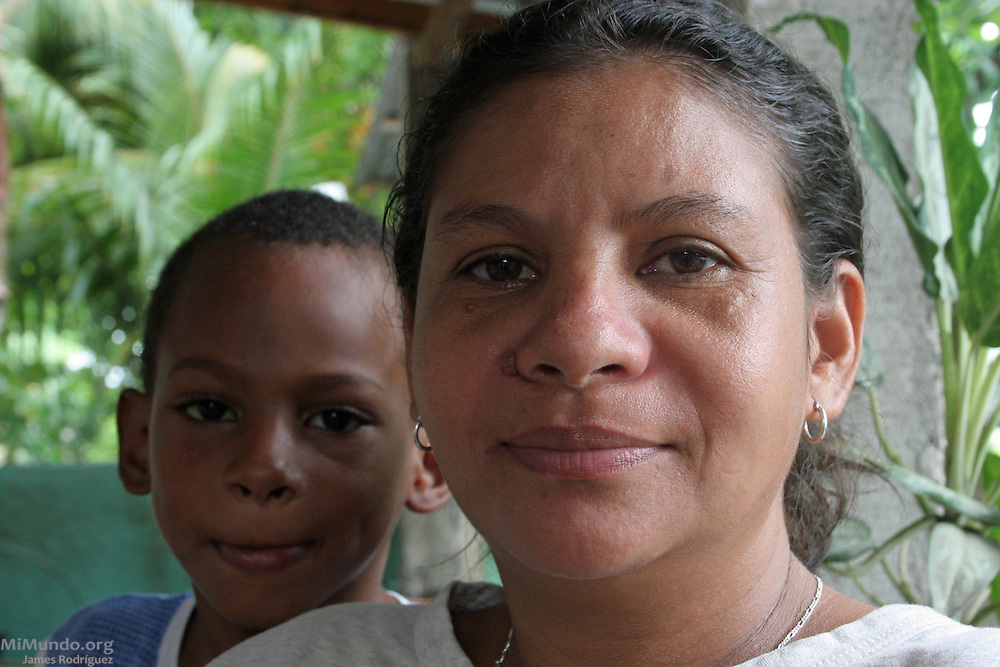 Teresa Reyes, recognized community leader and Garifuna political activist sits in her home in Triunfo de la Cruz. Garifuna communities, descendants of shipwrecked would-be African slaves, have inhabited most of the Central American Atlantic coast for over 200 years. Since the mid 1990's, mega-tourism projects threaten the continuity of the communities and the UNESCO-declared world heritage Garifuna culture and language as well. Tela, Atlántida, Honduras, July 2009.