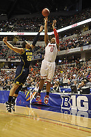Ohio State forward Jared Sullinger (0) puts up a 3-point attempt over Michigan forward Jordan Morgan (52) in the first half of the Big Ten Tournament semifinals in Indianapolis, on March, 11, 2011, at Conseco Fieldhouse. Ohio State defeated Michigan 68-61.