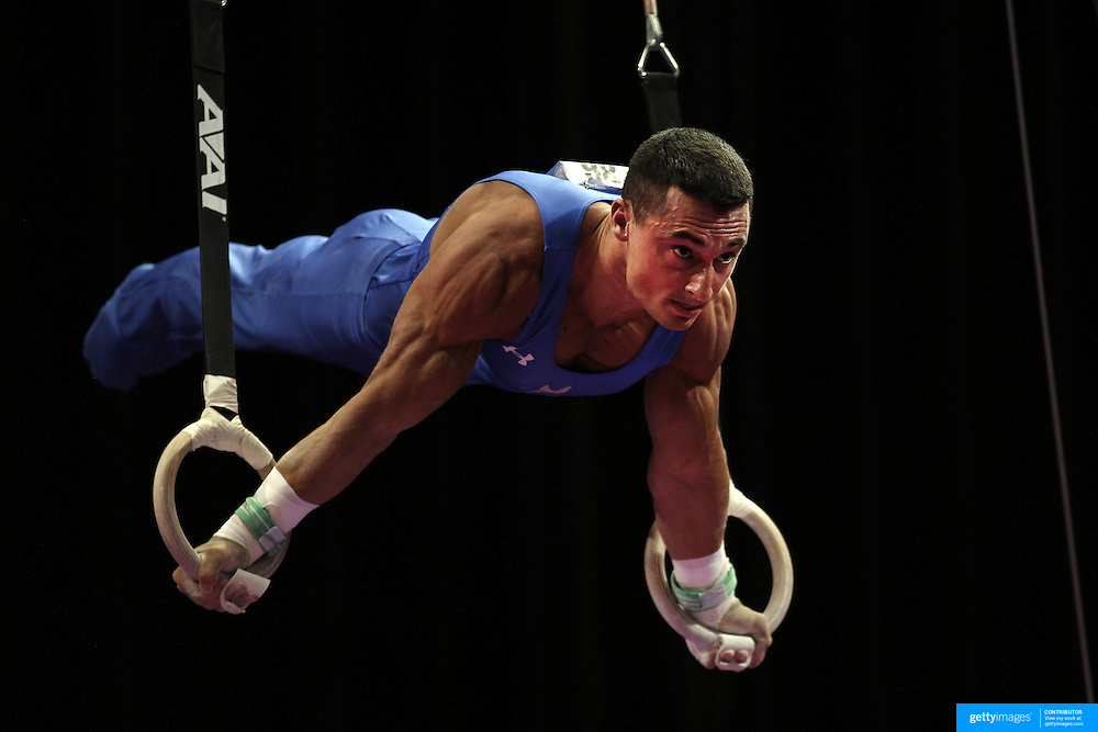 Brandon Wynn, Columbus, Ohio, in action on the <br /> Still rings during the Senior Men Competition at The 2013 P&amp;G Gymnastics Championships, USA Gymnastics&rsquo; National Championships at the XL, Centre, Hartford, Connecticut, USA. 16th August 2013. Photo Tim Clayton