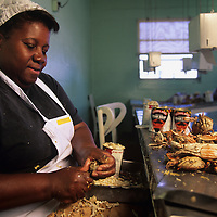 USA, Maryland, Crisfield, (MR) Nellie Ward picks Chesapeake Bay blue crabs by hand at the Maryland Crab Meat Co.