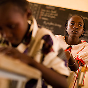 """Adjatou Traoré, 13, attends class at the Petit Paris primary school in the town of Dori, 240 km northeast of Burkina Faso's capital Ouagadougou on Monday May 11, 2009. When she was 12, Adjatou's mother attempted to sell her to a Ghanaian man who was trying to find his son a wife. She refused the marry the man. """"Early marriage is not a good thing,"""" she says, """"because a child should never have to give up school."""""""