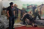 The artist Alfredo Gutierrez with his portrait of an American homeless man in Tijuana, Baja California, Mexico.<br /> <br /> &copy; Stefan Falke<br /> www.stefanfalke.com<br /> La Frontera: Artists along the US Mexican Border