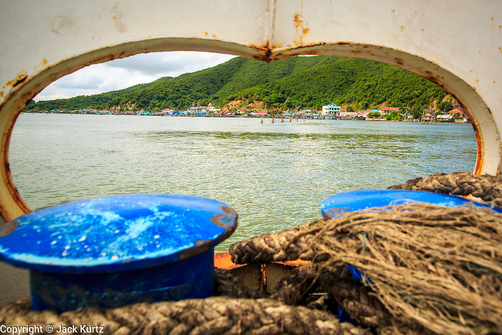 04 NOVEMBER 2012 - KAO SENG, SONGKHLA, THAILAND:  Looking toward shore from a ferry near Kao Seng. Kao Seng is a traditional Muslim fishing village on the Gulf of Siam near the town of Songkhla, in the province of Songkhla. In general, their boats go about 4AM and come back in about 9AM. Sometimes the small boats are kept in boat because of heavy seas or bad storms.    PHOTO BY JACK KURTZ