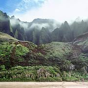 Sea cliffs rise spectacularly up to four thousand feet above Kalalau Beach on the Na Pali Coast, Kauai, state of Hawaii, USA.
