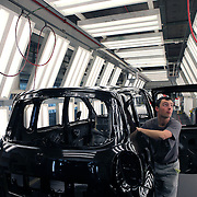 A worker checks a car at Renault plant in Valladolid, Spain, on Tuesday, April 4, 2010. Photographer: Markel Redondo/Bloomberg news.