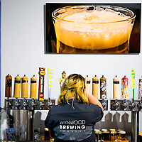 MIAMI, FLORIDA -- July 11, 2015 -- Beer lovers enjoy a large selection of local brews at Wynwood Brewery Company in the Wynwood Art District in Miami, Florida.  (PHOTO / CHIP LITHERLAND)MIAMI, FLORIDA -- July 11, 2015 -- Spray can tap handles hark to the art district as seer lovers enjoy a large selection of local brews and a regular food truck outside at Wynwood Brewery Company in the Wynwood Art District in Miami, Florida.  (PHOTO / CHIP LITHERLAND)MIAMI, FLORIDA -- July 11, 2015 -- Spray can tap handles hark to the art district as beer lovers enjoy a large selection of local brews and a regular food truck outside at Wynwood Brewery Company in the Wynwood Art District in Miami, Florida.  (PHOTO / CHIP LITHERLAND)