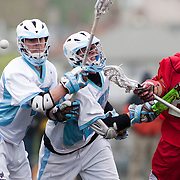 05/18/2011- Medford/Somerville, Mass. - Tufts midfielder Ryan Jorgensen (E13), left, and Tufts midfielder Nick Rhoads (A13) fight for a loose ball against Cortland State midfielder Justin Battino in the Jumbos 10-9 win over Cortland State in the NCAA Tournament Quarterfinals at Bello Field on May 18, 2011. (Kelvin Ma/Tufts University)