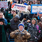 """Protests yell, """"Shame on You,"""" to Governor Rick Snyder during a protest against Emergency Financial Manager legislation at the Michigan State Capital in Lansing, MI, Tuesday, March 8, 2011. According to the law, which has already been approved in the House, the governor will be able to declare """"financial emergency"""" in towns or school districts and appoint someone to fire local elected officials, break contracts, seize and sell assets, and eliminate services. Under the law whole cities or school districts could be eliminated without any public participation or oversight. (Jeffrey Sauger)"""