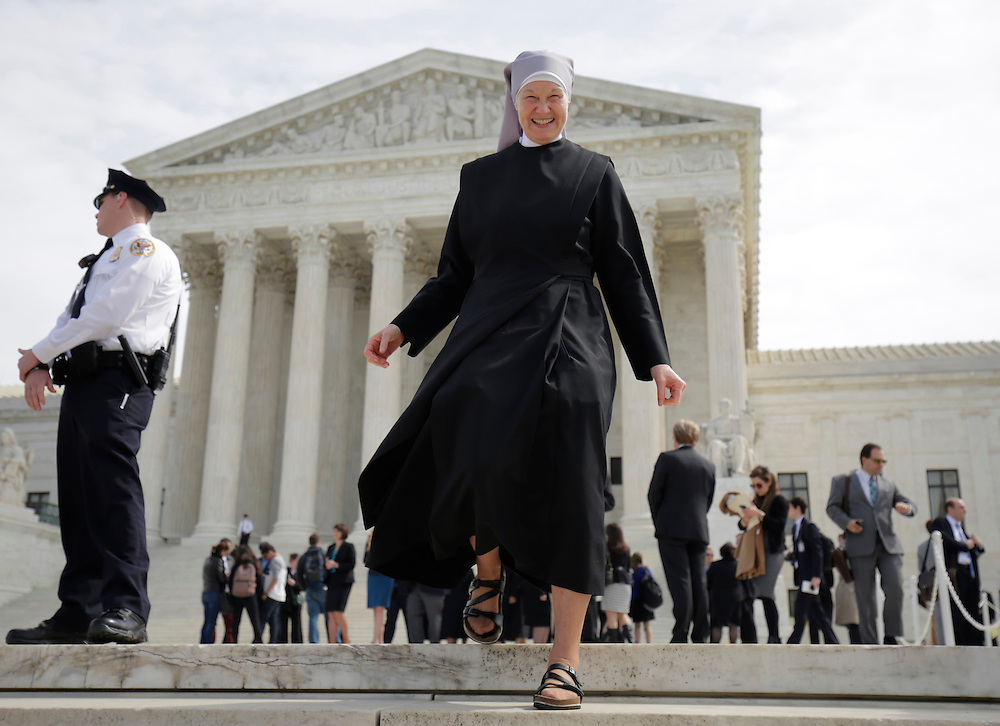 A nun with Little Sisters of the Poor walks after Zubik v. Burwell, an appeal brought by Christian groups demanding full exemption from the requirement to provide insurance covering contraception under the Affordable Care Act, was heard by the U.S. Supreme Court in Washington March 23, 2016.      REUTERS/Joshua Roberts