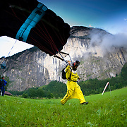 Andy Ross lands after a wingsuit BASE Jump in Lauterbrunnen Valley, Switzerland.