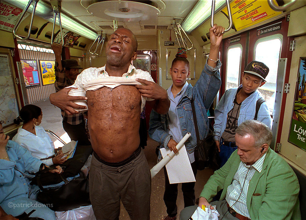Gregory Taylor, AIDS patient, panhandles on a Bronx train, baring his chest to show HIV-related symptoms. He got $55 in two round trips that day... people seemed to give so that he'd go away quickly. He lives at the Concourse Hotel.