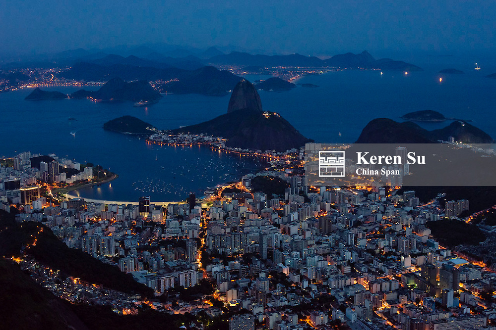Sugarloaf Mountain and cityscape in Botafogo Bay at night, Rio de Janeiro, Brazil