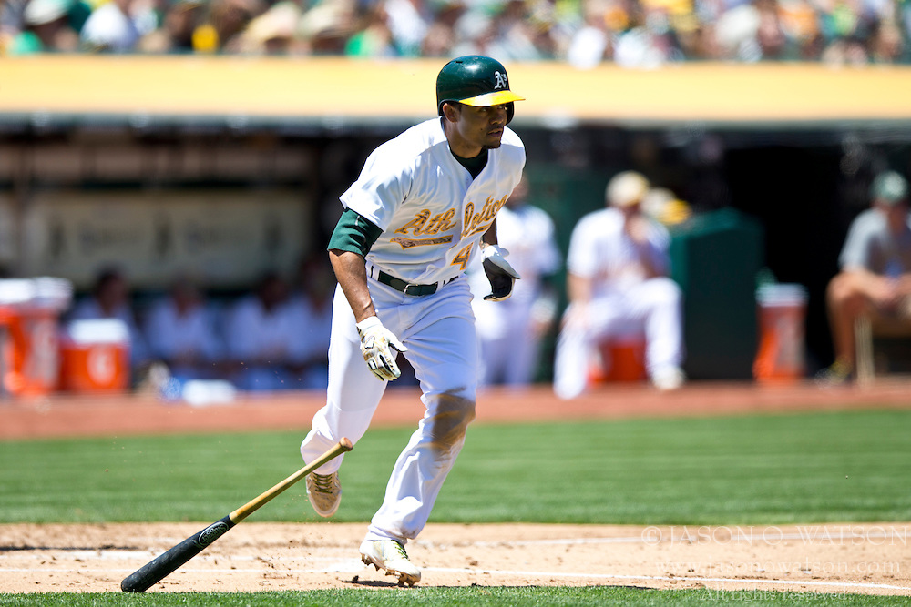 OAKLAND, CA - MAY 26:  Coco Crisp #4 of the Oakland Athletics at bat against the Detroit Tigers during the second inning at O.co Coliseum on May 26, 2014 in Oakland, California. The Oakland Athletics defeated the Detroit Tigers 10-0.  (Photo by Jason O. Watson/Getty Images) *** Local Caption *** Coco Crisp