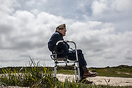 A veteran sitting in Point du Hoc where a german battery was taken by the US Rangers