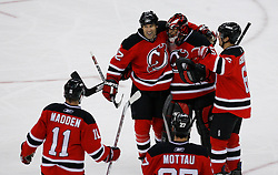 Jan 4, 2008; Newark, NJ, USA; New Jersey Devils center Brian Rolston (12) celebrates his game-winning goal with New Jersey Devils goalie Scott Clemmensen (35), New Jersey Devils center John Madden (11) and New Jersey Devils defenseman Andy Greene (6) during overtime at the Prudential Center. The Devils defeated the Senators 4-3 in overtime.