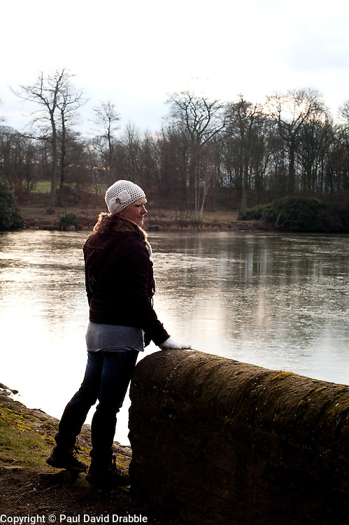 Aileen looking out over one of the frozen fishing ponds at Wentworth Woodhouse.29 January 2010.Images © Paul David Drabble