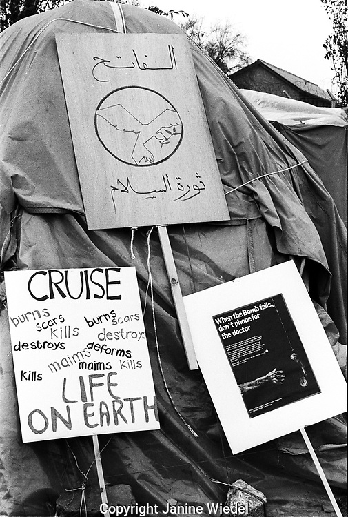 Protest signs at the anti-nuclear Greenham Common Women's Peace Camp in 1983 / 1984. The women only camp surrounded the RAF  base in Berkshire (UK) where American cruise missiles were being stored.