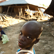 A boy near destroyed homes  in the village of Kpoto, Benin on Tuesday October 26, 2010.  Waters have receded in Kpoto, but most of the village was literally flattened by floods that have hit Benin over the past few weeks.