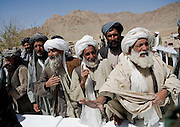 Local Afghan leaders, mostly poppy farmers air their greivances at a shura, or community meeting in Chenar, Kandahar province, Afghanistan that involved local Afghans, US military, Afghan governing officials, and NATO leaders in an area that is heavily influenced by the Taliban on Thursday, March 22, 2007.