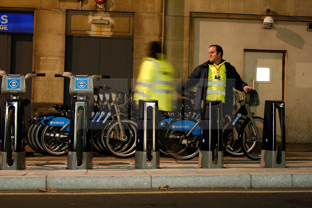 Tube Strike evening rush hour, 03 November 2010. Cycle hire staff at Belgrove Street King's Cross stack returning Boris bikes, by the hundred. © under license to London News Pictures. 03/11/2010.Tube Strike, RMT and TSSA members strike over job cuts and safety issues.