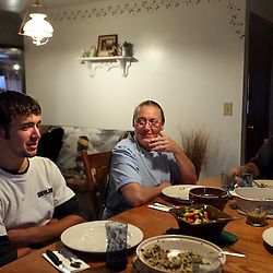 The Amish family of Jerry Schlabach is seen during dinner at their home in Berlin, Ohio, Oct. 13, 2009.