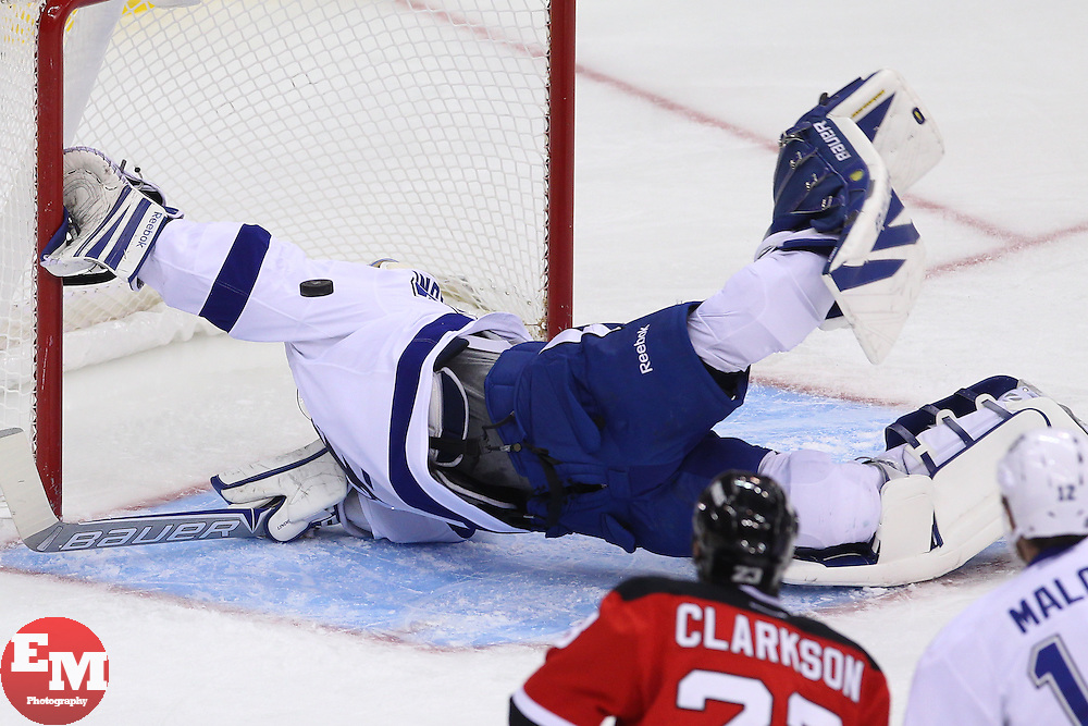 Feb 7, 2013; Newark, NJ, USA; Tampa Bay Lightning goalie Anders Lindback (39) makes a diving save on New Jersey Devils center Travis Zajac (19) (not shown) during the first period at the Prudential Center.