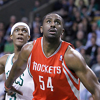 06 March 2012: Houston Rockets power forward Luis Scola (4)5 vies for the rebound with Boston Celtics point guard Rajon Rondo (9) during the Boston Celtics 97-92 (OT) victory over the Houston Rockets at the TD Garden, Boston, Massachusetts, USA.