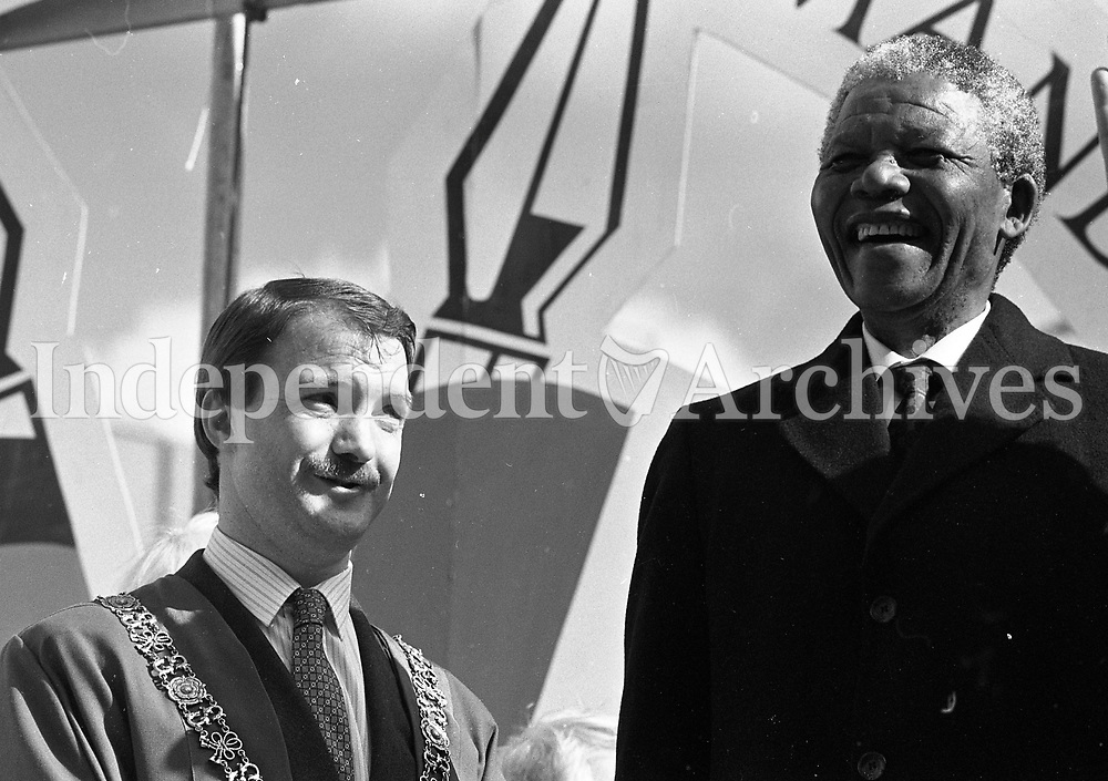 Nelson Mandela and the Lord Mayor, Sean Haughey greet the crowd at the Mansion House, 01/07/1990 (Part of the Independent Newspapers Ireland/NLI Collection).