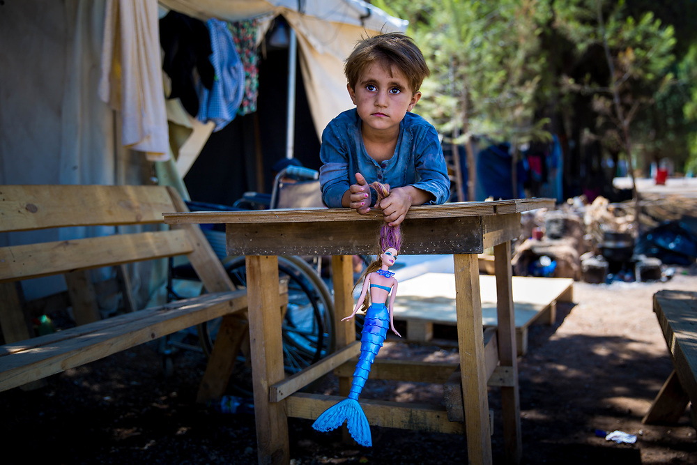 Najah, 4, a Kurdish Syrian refugee from Aleppo, plays outside her family&rsquo;s tent. Ritsona refugee camp, Greece. July 7, 2016.<br /> <br /> Najah and her extended family have been stranded in Greece since they arrived in March 2016, after the Balkan borders were closed to all refugees. According to the UNHCR, as of January 3, 2017, there are 704 refugees residing in Ritsona camp and a total over 33,000 in Greece. <br /> <br /> In July 2016 I documented refugee life in Ritsona Refugee Camp, Ritsona, Greece.