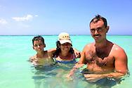 Family swimming at Guadalavaca, Holguin, Cuba.