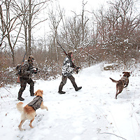 Duck hunters take a break with their dogs and their catch at Prairie Creek Reservoir in Muncie, Indiana Monday December 6. The reservoir was closed Monday so hunters could participate in a goose reduction hunt. The hunters were also able to shoot any waterfoul. .(Chris Bergin/ The Star Press).....
