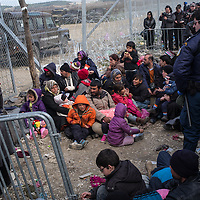 Refugees from Syria are seen waiting to cross the Macedonian Greek border next to the village of Idomeni, Greece. FEDERICO SCOPPA/CAPTA