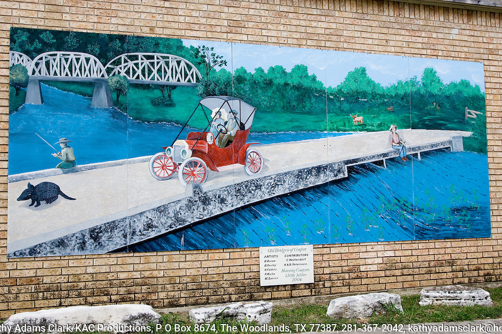 """""""Old Bridges of Comfort"""" a painting on the side of a building in downtown Comfort, painted by several artists to honor Comforts 150th jubilee in 2004."""