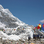 Tibetan Buddhist prayer flags flutter above Khumbu Basecamp during a Tibetan Buddhist puja ceremony, Khumbu, Nepal.