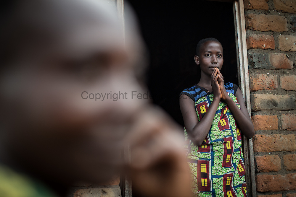 DRC / Burundi Refugees / Nunzimana Dafroza 14 years old Burundian refugee stand on the door of the house given to her and her brothers by the chief of Aebase village. More than 9000 Burundians refugees have crossed into the DRC over the past few weeks. The new<br /> arrivals are being hosted by local families, but the growing numbers are straining<br /> available support. Work is ongoing to identify a site<br /> where all the refugees can be moved, and from where they can have access to<br /> facilities such as schools, health centers and with proper security. / UNHCR / F.Scoppa / May 2015/ UNHCR / F.Scoppa / May 2015
