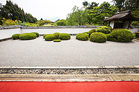 """Shoden-ji - the main attraction of the temple is its Karesansui garden, to be viewed from the deck of the temple's Hojo.  The garden is said to have been laid out by Kobori Enshu. Its unique dry garden makes use of """"borrowed scenery"""" in which the distant Mt. Hiei serves as one of the garden's main elements."""