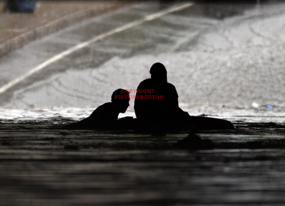 (07/10/10-Somerville,MA)  Somerville firefighterMike Marino rescues Christine Broderick from the roof of her car under the Mystic ave  tunnel after flash flooding.Boston Herald Staff photo by Mark Garfinkel