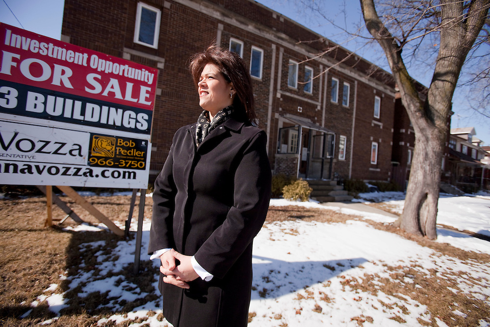 Windsor, Ontario ---10-02-19--- Anna Vozza, President of the Windsor/Essex Real Esate Board stands in front of an investment property consisting of 3 buildings close to downtown Windsor, February 18, 2010. The 3 properties have an asking price of $600,000. <br /> GEOFF ROBINS The Globe and Mail