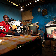 John Asare Abbey in the one-bedroom dwelling he shares with his wife in Agbogbloshie, a slum in Ghana's capital, Accra. He says he has lived here for 27 years.