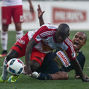 Philadelphia Union Defender FABIO ALVES (33) and New York Red Bulls Attacker BRADLEY WRIGHT-PHILLIPS (99) fight for the ball in the first half of a Major League Soccer match between the Philadelphia Union and New York Red Bulls Sunday, July. 17, 2016 at Talen Energy Stadium in Chester, PA.