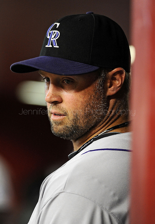 PHOENIX, AZ - APRIL 26:  Michael Cuddyer #3 of the Colorado Rockies   reacts in the dugout in the game against the Arizona Diamondbacks at Chase Field on April 26, 2013 in Phoenix, Arizona.  The Rockies defeated the Diamondbacks 6 to 3.  (Photo by Jennifer Stewart/Getty Images) *** Local Caption *** Michael Cuddyer