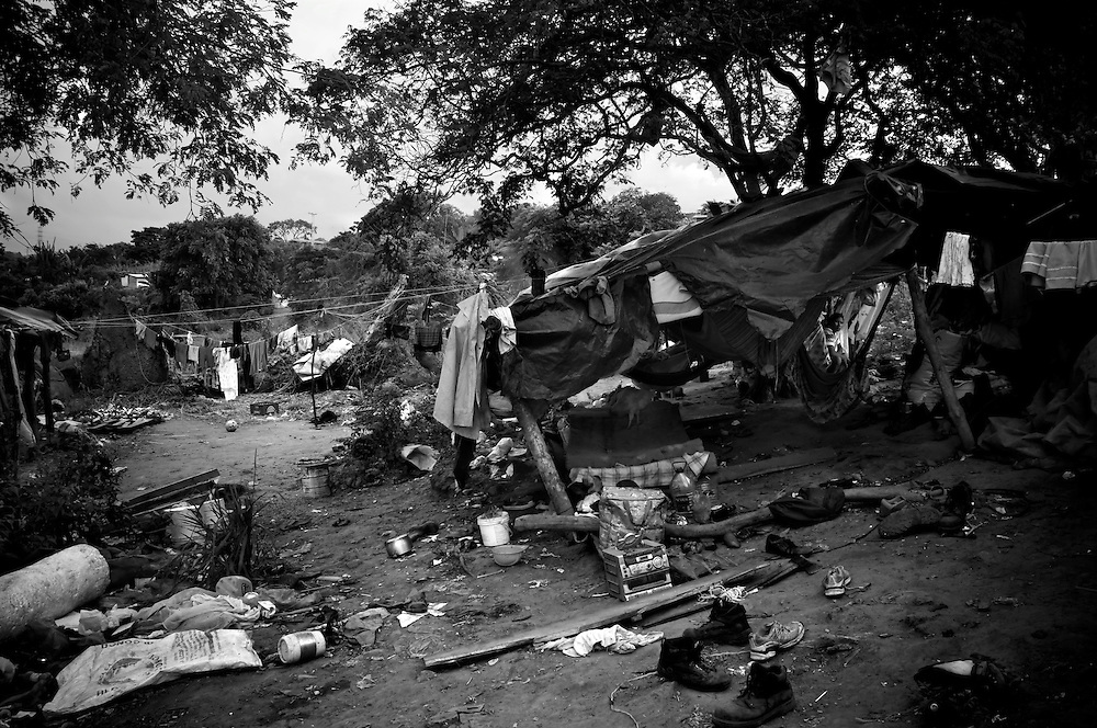 A Warao camp on the edge of Cambalache. In an effort to escape poverty, hunger and to be closer to health care facilities, approximately 300 Warao indigenous persons from the Delta Amacuro have settled in Ciudad Guayana, in northeastern Venezuela. The Warao sustain themselves and their families by salvaging recyclables, clothing and discarded food in Cambalache, located minutes from downtown Ciudad Guayana. Although Warao community leaders say their quality of life is improved in comparison to the conditions in the Delta, the Warao are still plagued by hunger and diseases consequential of the unsanitary conditions of living and working in Cambalache.