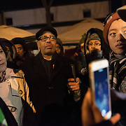 Minneapolis Mayor Betsy Hodges, left, listens as protesters with the Black Lives Matter movement, including Jie Wronski-Riley, right, talk to her about clashes between police and protesters that took place the previous night, as protesters gathered again outside the Minneapolis Police Department 4th precinct headquarters on Thursday, November 19, 2015 in Minneapolis, Minnesota. <br /> <br /> The Mayor, who arrived unannounced, was peppered with questions from a small crowd that surrounded her. <br /> <br /> Protests and an encampment at the site have been ongoing since the police shooting of 24-year-old Jamar Clark by Minneapolis Police on Sunday, November 15. <br /> <br /> <br /> Photo by Angela Jimenez for Minnesota Public Radio www.angelajimenezphotography.com