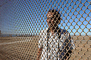 Tijuana Mexico ..border poet and activist Daniel Watman used to organize cross border poetry readings on both sides of the border fence in Playa Tijuana. Since the US added a second and much bigger fence to the border just recently, the meetings are being held with the use of sign language and megaphones...While working on this long term project 'La Frontera' I want to examine the cultural and humanitarian activities on both sides of a border that keeps the United States and Mexico apart with a wall of steel already 600 miles long. The turf wars of drug cartels, arms trafficking and rampant kidnappings turned cities like Tijuana into some of the most dangerous places on earth. Despite the violence many brave artists, photographers, architects, poets, humanitarians, teachers etc live and work in the shadow of the wall on both sides and have a positive influence on this region; they are the focus of my long term project along the border. (Over time I plan to cover the entire length from the Atlantic to the Pacific, these images were taken in and around Tijuana).© Stefan Falke