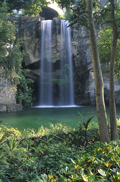 A waterfall in Hong Kong Park, Hong Kong, China.
