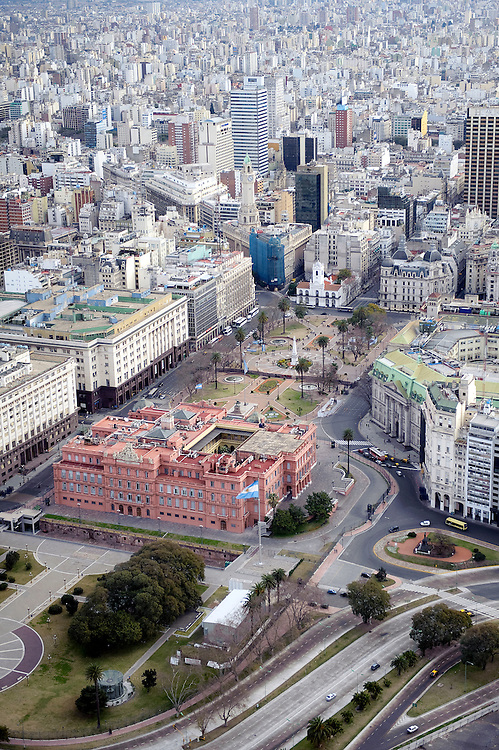 Buenos Aires, Argentina 22 August 2009<br /> Aerial view of La Casa Rosada, officially known as the Casa de Gobierno or Palacio Presidencial, is the official seat of the executive branch of the Government of Argentina. <br /> The Casa Rosada sits at the eastern end of the Plaza de Mayo, a large square which since the 1580 foundation of Buenos Aires has been surrounded by many of the most important political institutions of the city and of Argentina.<br /> Its balcony, which faces the square, has served as a podium for most Argentine Presidents and a number of other historical figures, including Eva Per&oacute;n, who rallied the &quot;descamisados &quot; from there, and Pope John Paul II, who visited Buenos Aires in 1982 and in 1987. Madonna, in 1995, sang her filmed rendition of the song &quot;Don't Cry for Me Argentina,&quot; for the movie Evita.<br /> PHOTO: EZEQUIEL SCAGNETTI