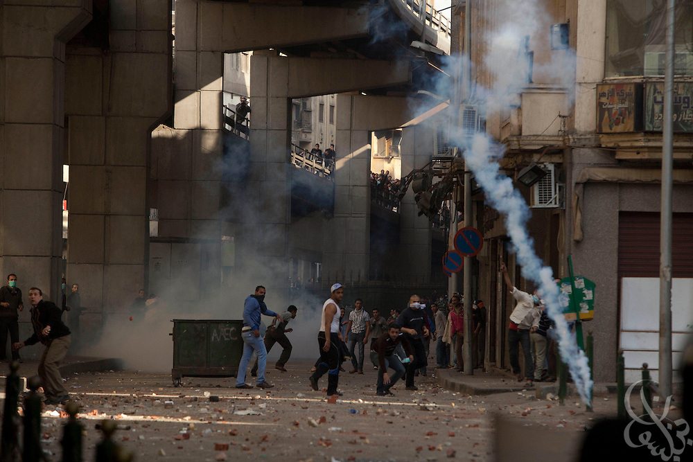 Egyptian protesters hurl stones, bricks and bottles towards police lines during massive and unprecedented demonstrations January 28, 2011 across Cairo, Egypt . The protests, inspired by the recent revolution in Tunisia, have struck a chord with Egypt's population, tired of inflation, high unemployment and alleged corruption within the Mubarak government..Slug: Egypt.Credit: Scott Nelson for the New York Times